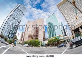 wide angle view busy design office. wide angle view of calgary downtown on centre street showing tall corporate office skyscrapers and the busy design i