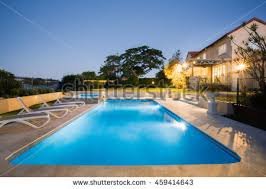 View modern house lights Beach View Of Modern House Or Hotel From The Pool Side Corner With Blue Water Illuminated With Underwater Lights Decoist View Of Modern House Or Hotel From The Pool Side Corner With Blue