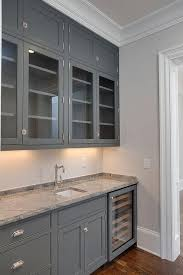 gray butler pantry cabinets with grey granite countertops