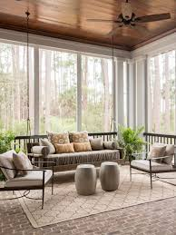 Large transitional brick floor and gray floor sunroom photo in Charleston  with a standard ceiling