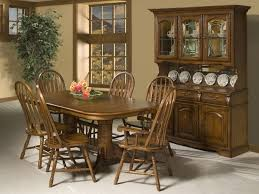 country style dining room with cappuccino finish china cabinet hutch amish american windsor dining chairsfloating