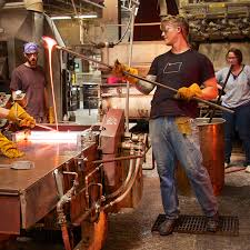 todd beaty casting supervisor demonstrates how to handle a ladle while casting photo mary kay nitchie bullseye glass