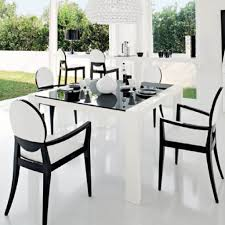 modern dining sets in black and white theme with rectangle black glass dining table and black and white wooden arm chair