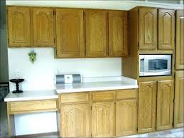 painting vs staining kitchen cabinets painting over varnished wood cabinets a custom kitchen cabinets painted vs