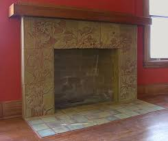 custom carved ginkgo fireplace by cha rie tang