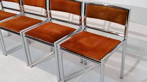 mid century dining chairs in tubular chrome and leather set of 4