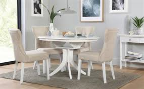 hudson round white extending dining table with 4 bewley oatmeal chairs
