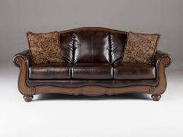 leather sofa with wood trim stunning couch impressive montego old world faux home ideas 7