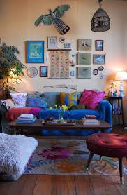 in this colorful living space the use of vertical spacefrom wall art to a hanging bohemian style living room