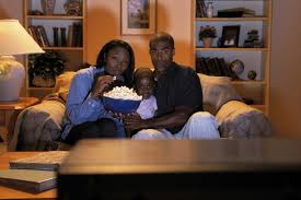 black kids watching tv. family watching scary movie at home black kids tv t