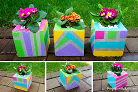 add some wow factor to your patio or balcony with these fun colorful painted cinder