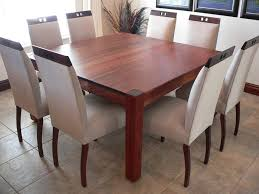 dining room along with leather parsons chairs in a black or espresso a regular height table that is square that seats 2 on each side with an extension