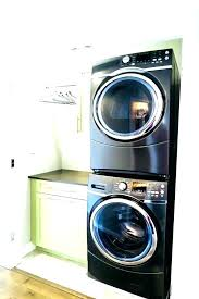 stackable washer dryer closet design stacked cabinet laundry room with and height stac