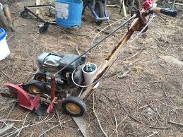 picture of converting a lawn mower or edger from gasoline to run on propane