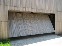 garage door opening on its ownBest 25 Garage door rollers ideas on Pinterest  Sectional garage