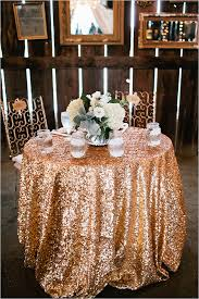 sweetheart table with sparkly gold sequin table cloth, I can't imagine  anything being