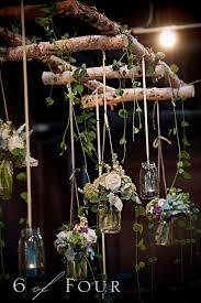 natural elements mason jars and the twig ladder make this wedding settings more than visually