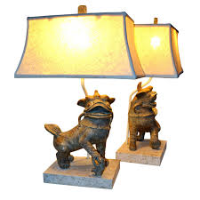 pair of ceramic foo dog lamps on fossil stone bases circa 1960