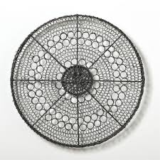 small round metal wall art