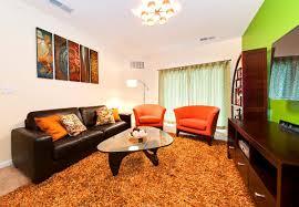 Orange And Brown Living Room Decor Living Room Orange Cushions Lampshade Decor Sofa Set Geometric