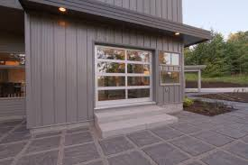 exterior detail of living room operable fire station garage door for patio modern