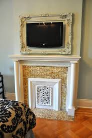 lovin the idea of framing the wall mounted tv with a vintage frame that