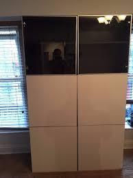 ikea besta storage combination blackbrown frame gloss white and