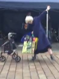 she suddenly ditches her zimmer frame to play air guitar to the amazement of passersby