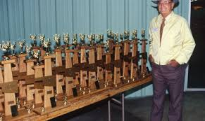 rus pierson is shown here in 1994 next to trophies for the national land and range