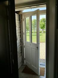 when the new door is made shorter there will be even more timber frame above than is there now there just seems to be too much white around the door