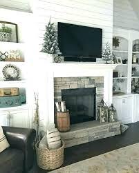 white fireplace built ins around brick