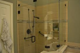 the over sized shower is so beautiful it is like being at a spa or luxury hotel i love the large tiles the glass tile trim and the rubbed bronze