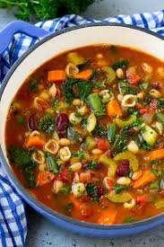a pot of olive garden minestrone soup loaded with vegetables beans and pasta
