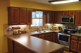 over the counter lighting removed the cabinets over peninsula soffit above added recessed lighting changed