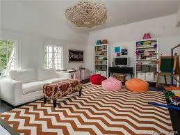 perfect vinyl area rugs traditional playroom with hardwood floors chandelier in