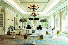 beautiful ritz lighting style. a carpeted space with large arched windows and caf tables for two beautiful ritz lighting style