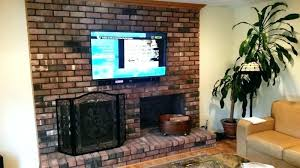 mounting flat screen tv over brick fireplace home interior