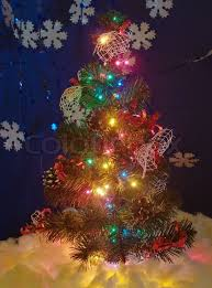 Christmas Tree With Glowing Garland Stock Photo Colourbox