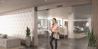 assa abloy sl500 all glass sliding door system with transpa option for interior environments