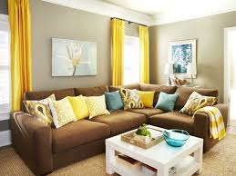 living room brown brown sofa beige walls yellow curtains
