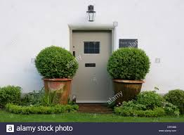 The front door, flanked by two ornamental potted trees, of Bank ...