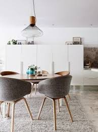 house tour a light contemporary apartment in melbourne gallery vogue living love the chairs find this pin and more on the mid century modern dining
