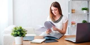 home office work. Woman Developing A Home Office Strategy Work
