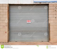 Galvanized Roller Door With NO PARKING Sign Stock Image - Image ...