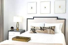 full size of white walls frame a beautiful beige upholstered black framed art headboard complementing deco
