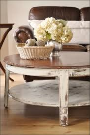 beautiful white and wood top vintage distressed coffee table round to setup living room decoration