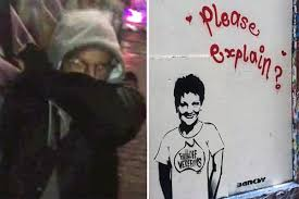 Banksy has 'been unmasked' as video catches him red-handed spray painting  wall
