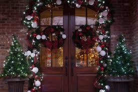 how to hang garland around front doorHow to Decorate with Christmas Greenery
