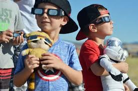 eclipse watchers marvel at totality in john day local news  gabriel porter of sandy right reacts to the start of the eclipse while