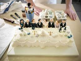 Wedding Cake With Top Table Decoration In Bakery High Angle View